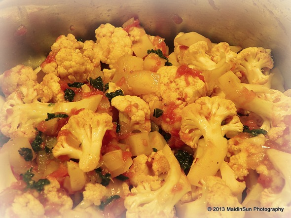 Spicy cauliflower and potatoes with kale