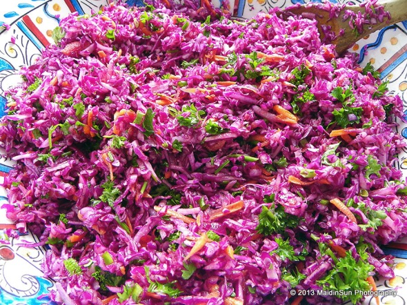 More Red Cabbage Slaw because it's so colorful.  The dressing is made with olive oil, lemon juice & zest, and garlic.